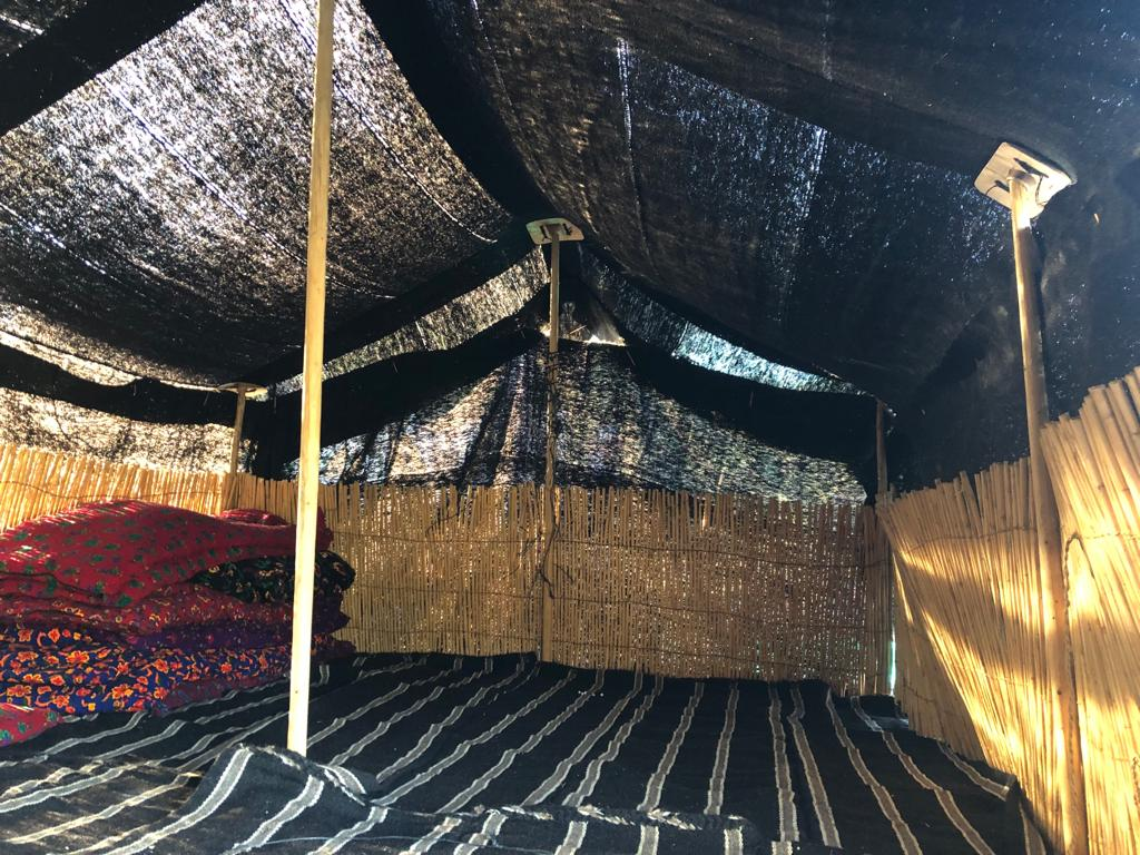 Anatolian Turkmen Black tent view from the inside with the reed screens placed on the edges