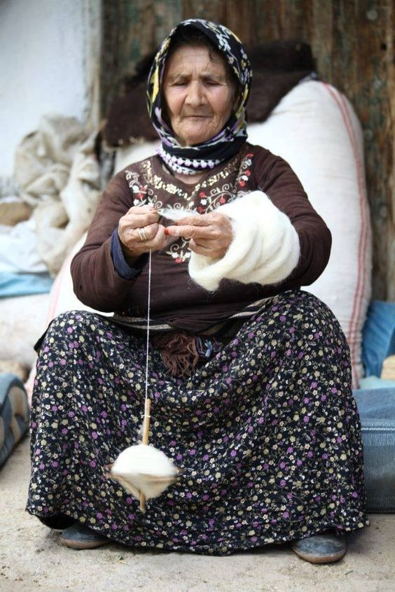 A Turkmen lady from Konya spins wool with drop spindle, Cental Turkey, 2017