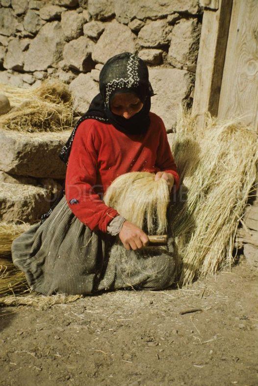 Anatolian village woman combing hemp to be spu and woven. Central Turkey, photo courtesy Josephine Powell, Suna Kıraç Foundation