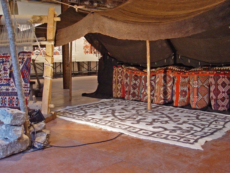 Personal clothing sacks of Anatolian Turkmens put in the tent, forming a platform to sit in front. Joephine Powell exibition, Koç Foundation, 2006