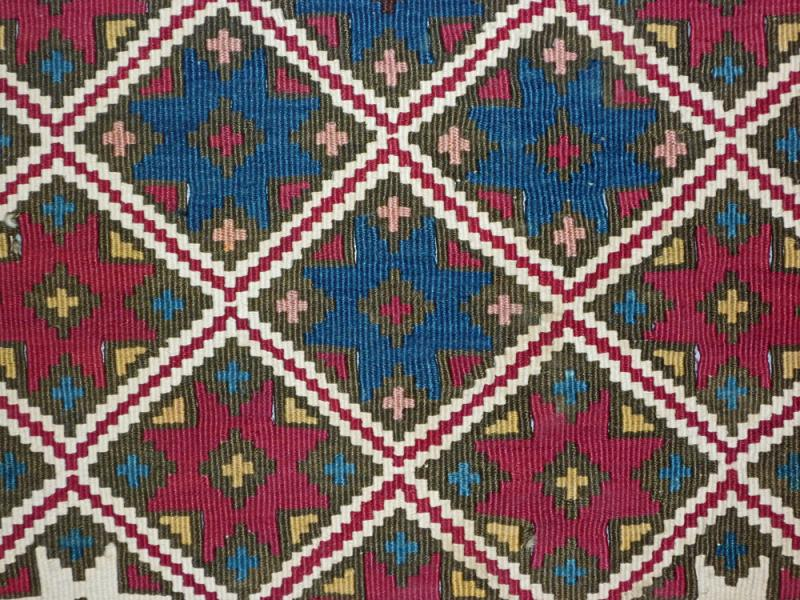 A kilim from Adıyaman, South Eastern Turkey,, with cochineal red, mid-19th century
