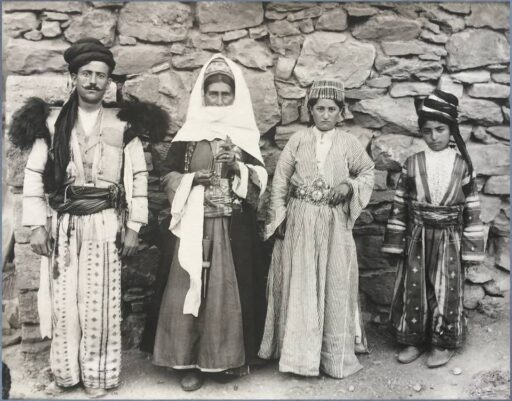 An Armenian family from Çatak, Van area, with the clothing they wove and tailored for their own use. the beginning of 20th century, Eastern Turkey