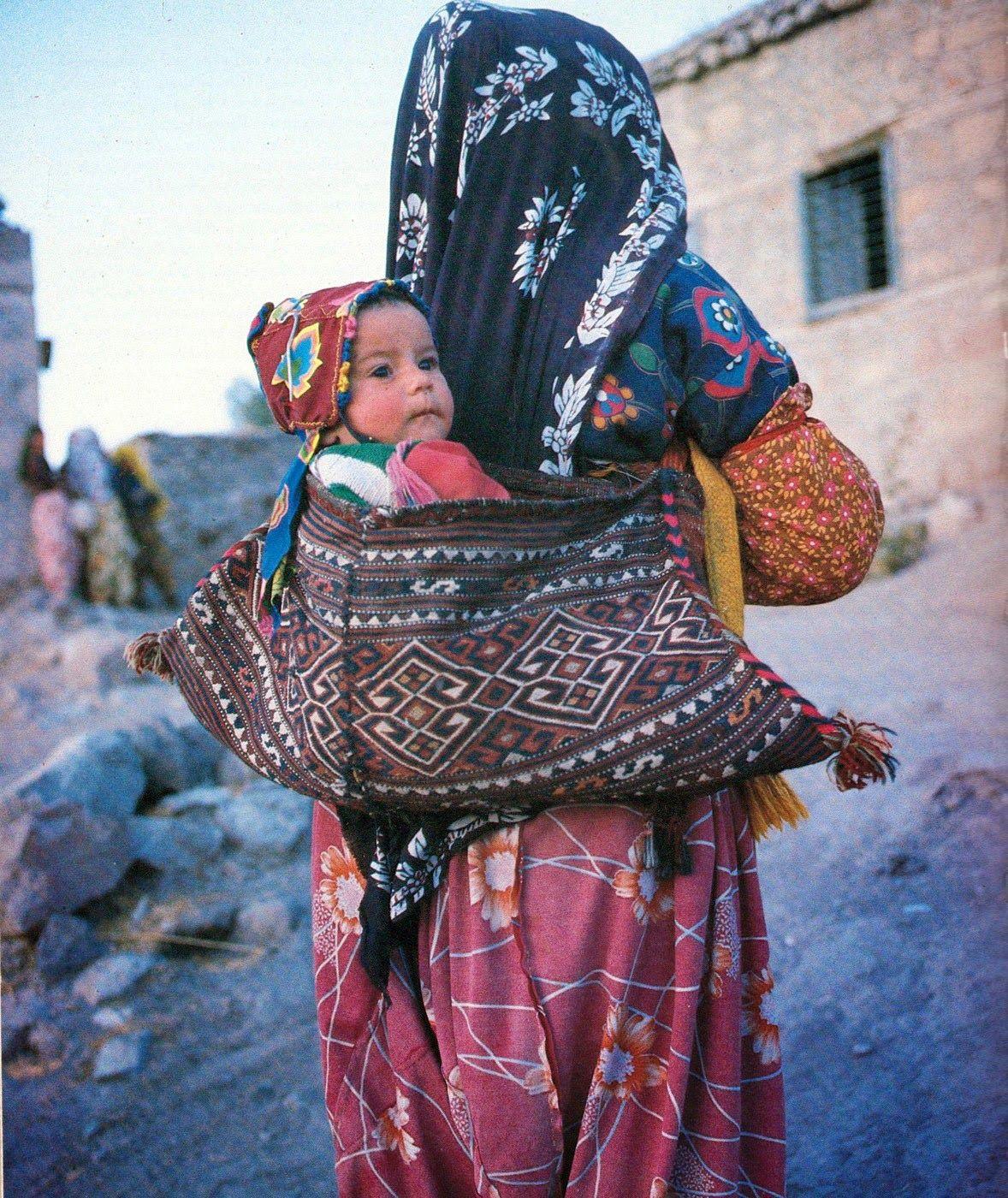 The nomadic way of carrying babies, Shavak tribeswoman Tunceli, Eastern Turkey, 1988