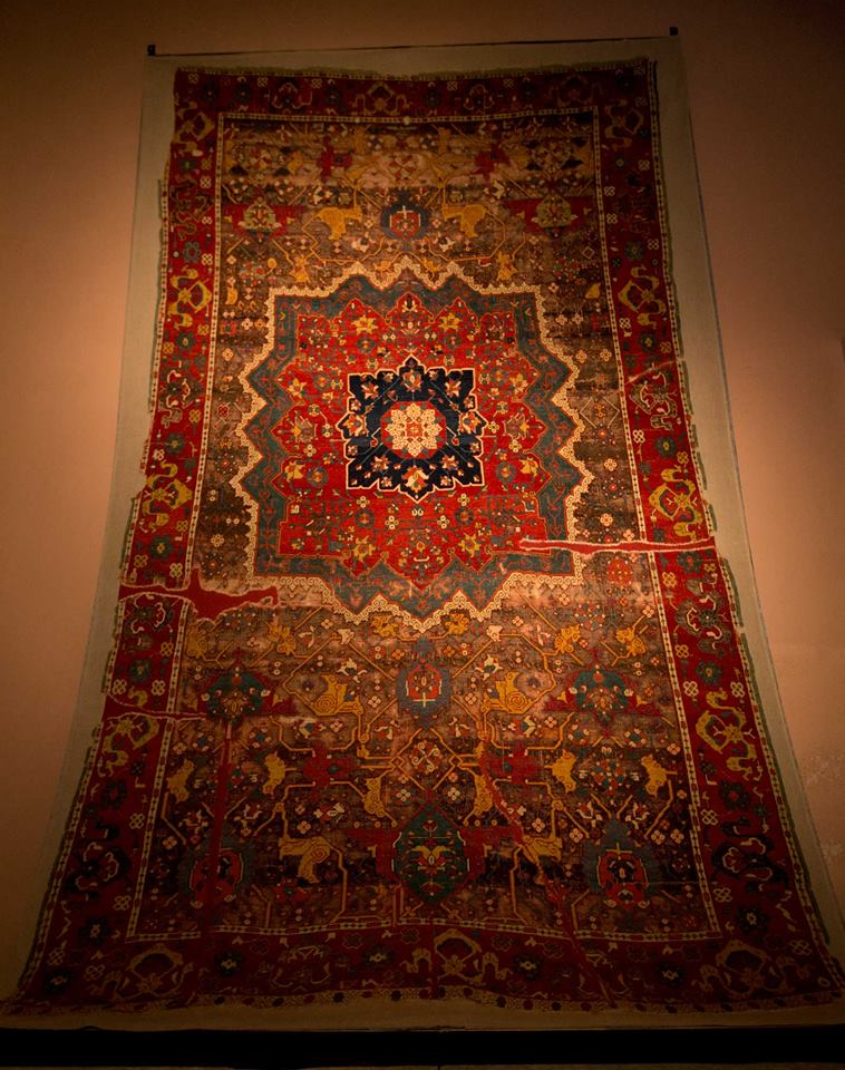 15th century Eastern Anatolian workshop carpet with very fine structure and floral and cloudband patterns with Persian Effect. Vakiflar Museum